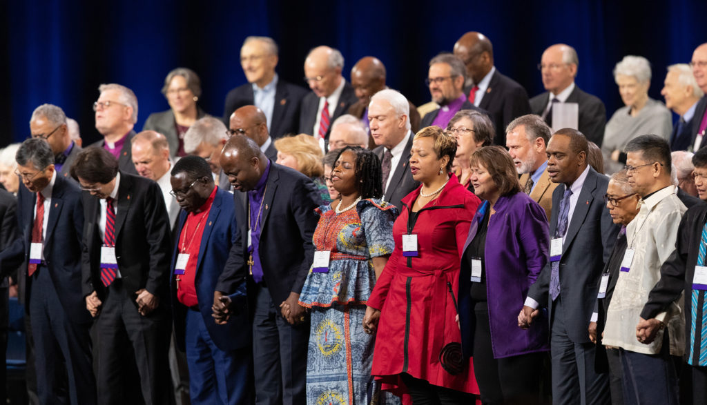 United Methodist bishops hold hands in prayer during a day of prayer for the 2019 United Methodist General Conference in St. Louis. Photo by Mike DuBose, UMNS.